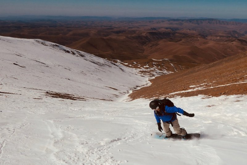 Snowboarding Morocco, looking out over the Sahara.